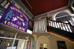 Working Class library: Banners on the staircase