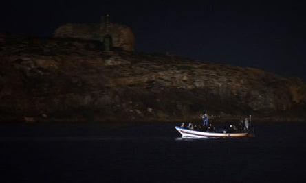 A boat carrying migrants enters Lampedusa