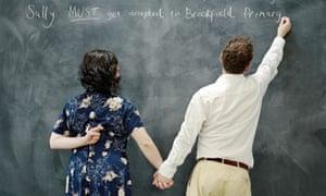 School admissions: parents write on blackboard