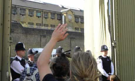 People protest at Brixton prison against the 'excessive' sentencing