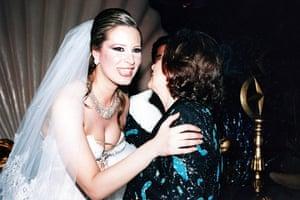 Gaddafi family photos: Gaddafi's daughter Aisha, left, hugging a guest on her wedding day