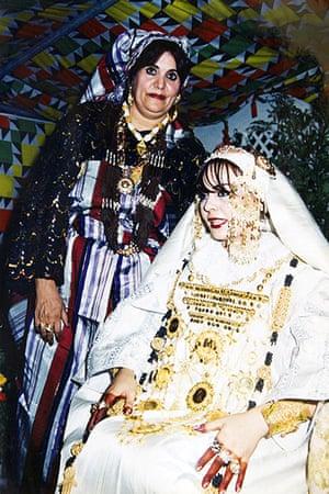 Gaddafi family photos: Muammar Gaddafi's wife Safiya (standing), during a family wedding