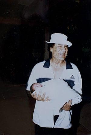 Gaddafi family photos: Colonel Muammar Gaddafi with an unidentified infant