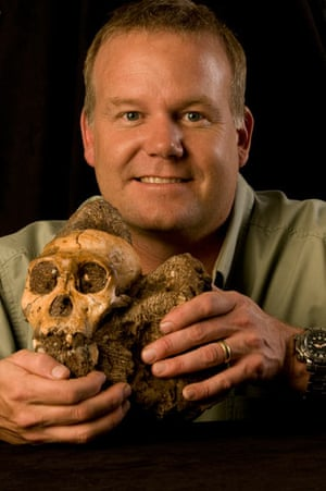 Primitive hominin: Prof Lee Berger with the Australopithecus sediba cranium