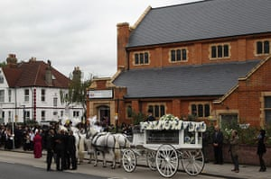 Funeral of Mark Duggan: The cortege arrives at the church