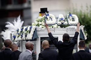 Funeral of Mark Duggan: A man removes a floral tribute