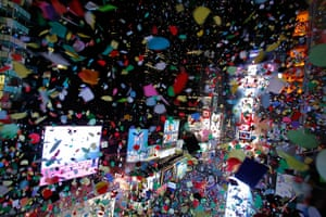 New year celebrations: Confetti is dropped on revellers in Times Square in New York