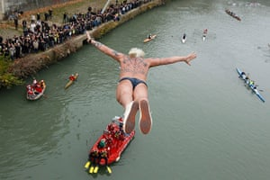 New Years day swimmers: Maurizio Palmulli of Italy dives into the Tiber river, Rome