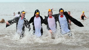 New Years day swimmers: People enjoy a New Year's Day dip at Whitley Bay in Northumberland