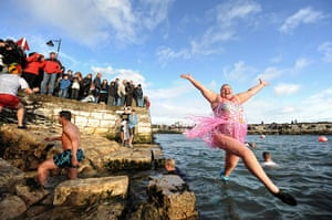 New Years day swimmers: Angela McClements makes a graceful entrance at Carnlough Harbour