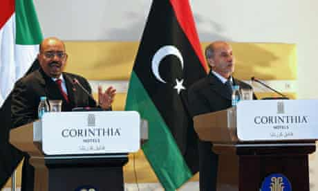 Omar al-Bashir speaks during a joint news conference with Libya's NTC chief, Mustafa Abdel Jalil