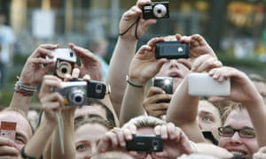 Movie fans using their cameras and mobile phones to snap pictures of stars on the red carpet