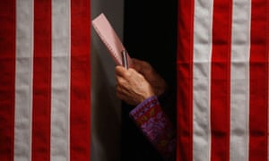 A voter checks her ballot in Balsams Hotel in Dixville Notch, New Hampshire