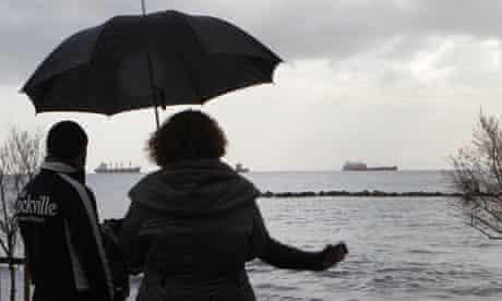 People look at ships at Limassol port