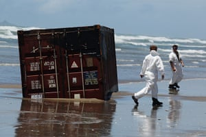 Rena breaks up: Volunteers check on washed up containers at Waihi Beach