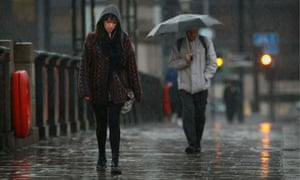 Depressed-looking woman in the rain