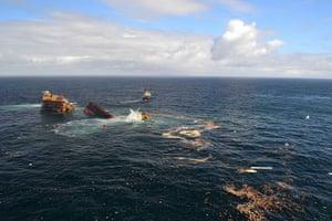 Rena breaks up: Debris floats around the stricken container ship Rena