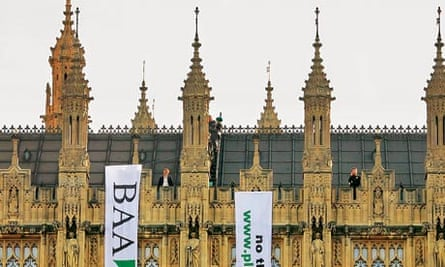 Tamsin Omond protests with Plane Stupid on Houses of Parliament