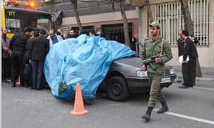 The car belonging to Iranian nuclear scientist Mostafa Ahmadi-Roshan at the blast site in Tehran