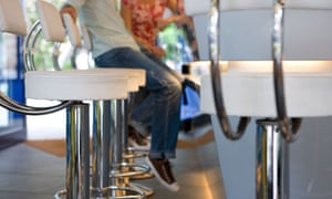 A couple sitting on bar stools