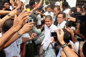Burma prisoner released: Released prisoners walk out of Insein jail in Rangoon