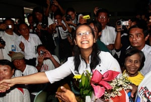 Burma prisoner released: Nilar Thein shakes hands as she arrives at Rangoon airport