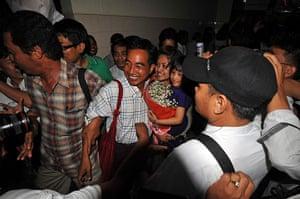 Burma prisoner released: Zaw Thet Htwe is welcomed upon his arrival at Rangoon airport