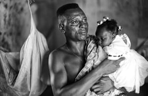Bono visits Ghana: A father with his child