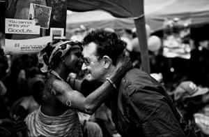 Bono visits Ghana: Bono meets a villager in Kpasenkpe
