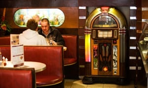 Customers by the jukebox at Cafe d'Jaconelli on Maryhill Road, Glasgow