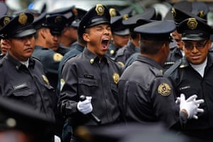 24 hours: Mexico City, Mexico: A police officer yawns during a parade