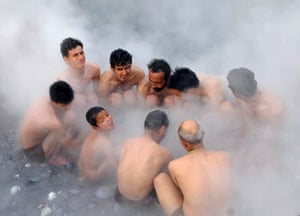 24 hours: Tattapani, India: Hindu devotees bathe in a natural hot water spring