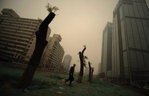 China environmental year: A man walks through heavy pollution on a street in Beijing