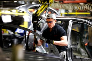 Nissan: An employee fits a car door