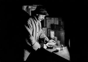 south pole expeditions: Herbert Ponting in his makeshift darkroom