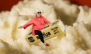 Paula Deen riding a stick of butter