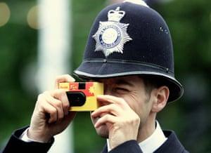 Kodak: 4 June 2006: A policeman takes a picture with a Kodak disposable camera