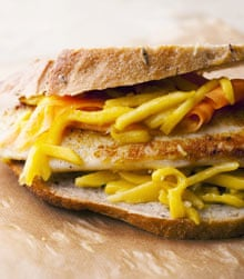 Fish sandwich with green mango dressing.