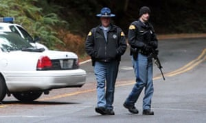Washington state troopers stand guard at the entrance to Mount Rainier national park