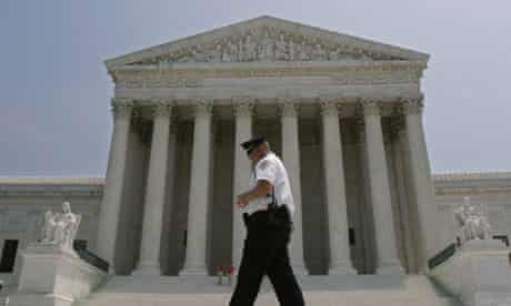 Police officer patrols outside US Supreme Court after Justice OConnor announced her resignation