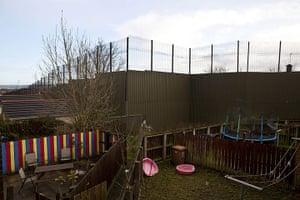 Peace Wall: The Peace Wall that runs Towards Newtownabbey in Belfast