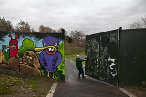 Peace Wall: A Park employee closing the peace wall at 3pm in Belfast