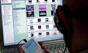 A man downloading music legally via iTunes