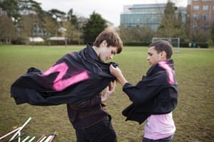 Muggle Quidditch: Worcester College players help each other with their robes