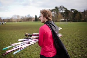 Muggle Quidditch: Worcester College's Mycchaka Kleinbort carries broomsticks to the pitch