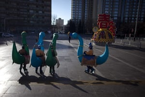 Chinese new year : Temple fair performers with cartoon-dragon-shaped balloon costumes