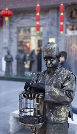 Chinese new year : Street performers dressed as statues of old characters entertain shoppers