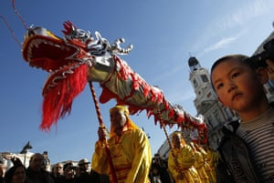 Chinese new year : A boy watches the Lunar New Year celebrations in downtown Madrid, Spain