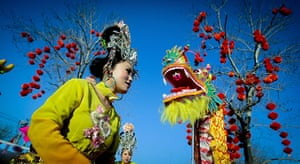 Chinese new year : Actors perform on the eve of the New Year of the Dragon at a park, Beijing