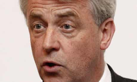 Andrew Lansley has defended his NHS reforms after a highly critical report from MPs